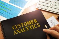 Document with name customer analytics. stock photo