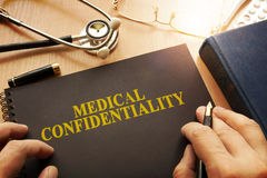 Document with name medical confidentiality. Document with name medical confidentiality on a table royalty free stock image