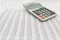 Document with numbers in several columns, calculator Royalty Free Stock Images
