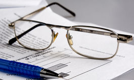 The document, pen, glass Royalty Free Stock Photography