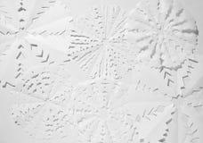 Document sneeuwvlokken op witte achtergrond royalty-vrije stock foto's