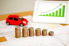 Document some graphics with calculator and car and mone Stock Images