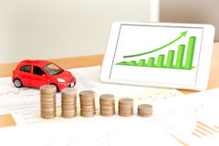 Document some graphics with calculator and car and mone Stock Image