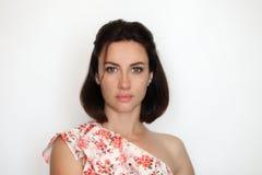 Document style headshot portrait of adult beautiful brunette woman posing against white backdrop. Document style headshot portrait of adult beautiful brunette Stock Image