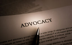Document with the title of advocacy. Closeup royalty free stock photos