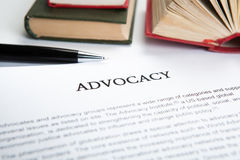 Document with the title of advocacy. Closeup stock image