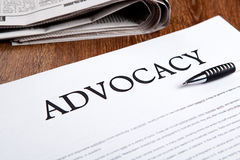 Document with the title of advocacy. Closeup Royalty Free Stock Photo