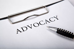 Document with the title of advocacy and pen. Document with the title of advocacy close up royalty free stock images