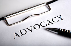 Document with the title of advocacy. And pen close up Stock Photo
