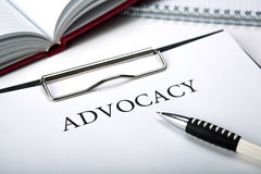 Document with the title of advocacy and pen. Document with the title of advocacy close up stock photo