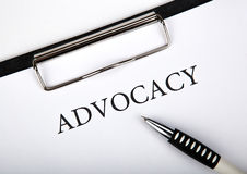 Document with the title of advocacy. And pen close up royalty free stock photography