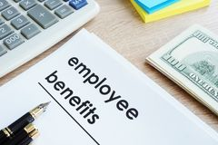 Document with title employee benefits. Document with title employee benefits on a desk Royalty Free Stock Photo