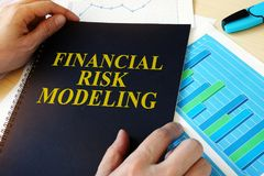 Document with title Financial risk modeling. Document with title Financial risk modeling on a desk stock image