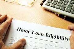 Document with title Home Loan Eligibility. stock photo