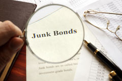 Document with title junk bond on a table. Selective focus Stock Photos