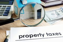Document with title Property tax. Document with title Property tax on a desk royalty free stock image