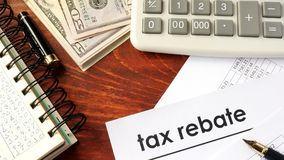 Document with title tax rebate. Royalty Free Stock Images