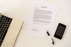 Document waiting for sign on business table stock photo