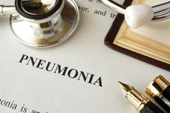 Document with word pneumonia in a hospital. Lung diseases concept Royalty Free Stock Photos