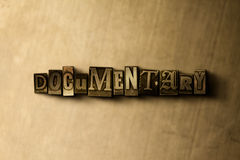 DOCUMENTARY - close-up of grungy vintage typeset word on metal backdrop Stock Image