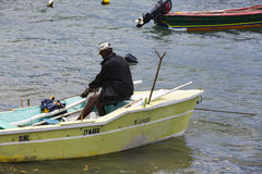 Documentary editorial image. Fisherman on small wood boat Royalty Free Stock Images