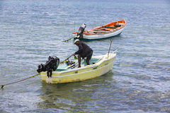 Documentary editorial image. Fisherman on small wood boat Royalty Free Stock Photos