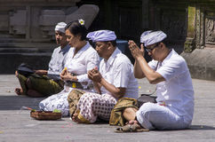 Documentary editorial image. People praying in the temple, religion hinduism Buddhism, Bali. Indonesia Stock Photography