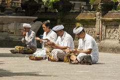 Documentary editorial image. People praying in the temple, religion hinduism Buddhism, Bali. Indonesia Stock Photo