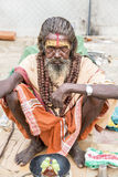 Documentary editorial image,Poverty in the street India. Documentary editorial image. Pondicherry, Tamil Nadu, India - June 25 2014. Very poor man and woman Royalty Free Stock Image