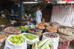 Documentary editorial image. An unidentified Indian at his fruit and vegetable shop in a small rural village market in Tamil Nadu. Stock Photography