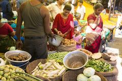 Documentary editorial image. An unidentified Indian at his fruit and vegetable shop in a small rural village market in Tamil Nadu. Stock Photos