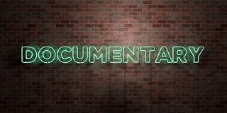 DOCUMENTARY - fluorescent Neon tube Sign on brickwork - Front view - 3D rendered royalty free stock picture Stock Photos