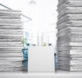 Documentation. A stack of white papers lie on a desk in an office room. 3d illustration stock photo