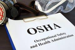 Documenten met Dienst voor arbeidsveiligheid en -hygiëne OSHA royalty-vrije stock foto's
