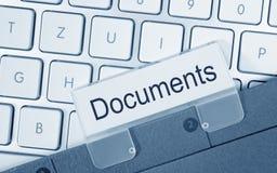 Documentenomslag op computer Stock Afbeelding