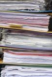 Documenti del og della pila nei raccoglitori Fotografia Stock
