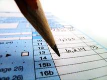 Documenti di imposta per le tasse d'archivio in America 1040 e matita immagine stock libera da diritti