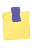 Documenti gialli con il contrassegno blu in bianco Fotografia Stock