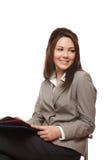 Documenti positivi della holding della donna di affari immagini stock