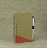 Documenting days and night. A notebook with a pen on a textured background Stock Photos