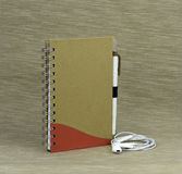 Documenting days and night. A notebook with a pen on a textured background Stock Images