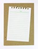 Documento in bianco del taccuino con la riga su documento marrone Immagine Stock Libera da Diritti