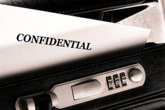 Documento clasificado confidencial en cartera Fotografía de archivo libre de regalías