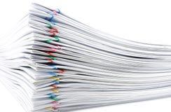 Documento da sobrecarga da pilha no fundo branco Imagens de Stock Royalty Free