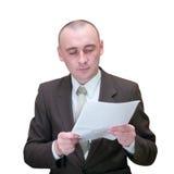 Documento de la lectura del hombre de negocios Imagen de archivo