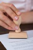Documento de Person Hands With Stamper And Foto de archivo libre de regalías