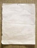 Documento del Pin sobre una pared Fotos de archivo