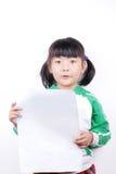 Documento della holding della ragazza dell'Asia fotografia stock