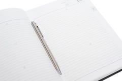 Documento di nota con la penna Fotografie Stock Libere da Diritti