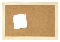 Documento en blanco sobre tarjeta del corcho Fotos de archivo